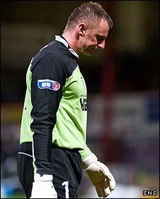 Dejected Dundee goalie Rab Douglas