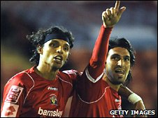 Hugo Colace (right) celebrates his winner for Barnsley
