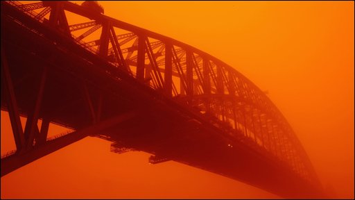 Sydney Harbour bridge in a cloud of reddish dust