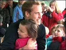 Prince William hugging five-year-old Lily Slater at a Wellchild charity event in July 2009