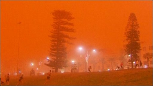 People exercise as red dust covers Sydney