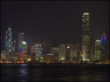 Buildings on Victoria Harbour lit up by night