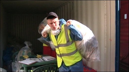 Man removing bags of rubbish