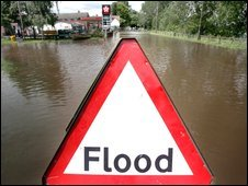 A sign warns of floods in a residential street in Upton on Severn near Worcester, England
