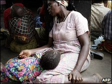 Mother and sick child in Malawi (Oct 2005)