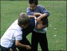 Boys play fighting