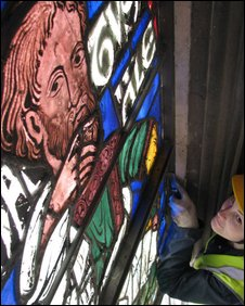 Conservator Joy Bunclark removes the 12th Century depiction of Methusaleh