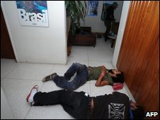People sleep on the floor of the Brazilian embassy