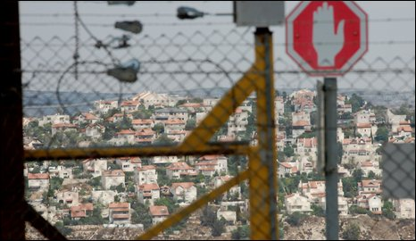 Givat Ze'ev settlement, seen through West Bank barrier (photo Martin Asser/BBC)