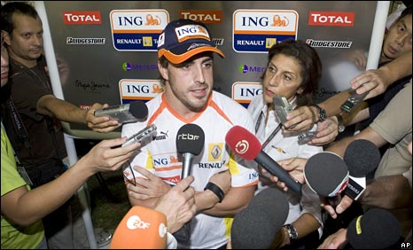 Fernando Alonso is quizzed by the media in Singapore