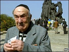 A man cries as he remembers all his family killed by the Nazis at Babi Yar ravine, at the monument to victims in Kiev, Ukraine (Sept 2003)
