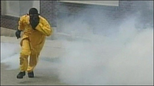 Protestor running as tear gas spreads
