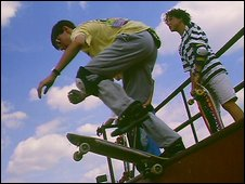 Boy on skateboard ramp