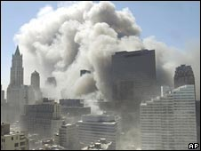 Smoke rises into the sky following the collapse of World Trade Center Tower 11/9/01
