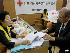 A man checks a list at the Korea Red Cross in Seoul, South Korea, 21 September 2009