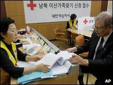A man checks a list at the Korea Red Cross in Seoul, South Korea, 21 September 2009