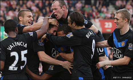 United players celebrate John O'Shea's goal