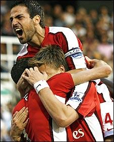 Arsenal celebrate Robin van Persie's goal