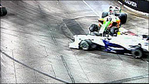 Force India's Adrian Sutil spins into the path of  BMW's Nick Heidfeld