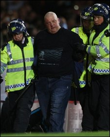 A man is led away at Upton Park
