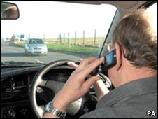 A man driving while using a mobile phone