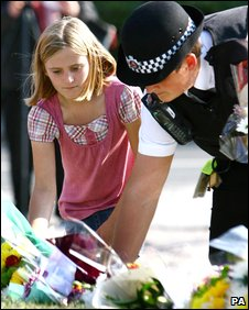 Floral tributes being placed at the scene of the crash