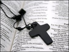 A cross on an open bible