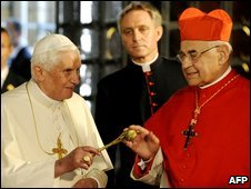 Pope Benedict XVI and Czech Cardinal Miroslav Vlk, right, exchange greetings in Prague, Czech Republic, 26 September 2009