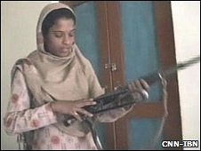 (Picture courtesy of CNN-IBN) - Rukhsana Kauser with the AK-47 she grabbed from the militant - 29 09 2009