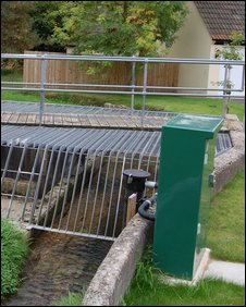 The green telemetry box helps measure the town's water levels
