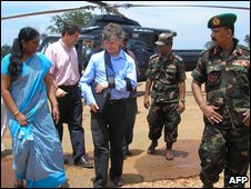 Walter Kalin (C) visits Sri Lankan war refugees in the district of Vavuniya