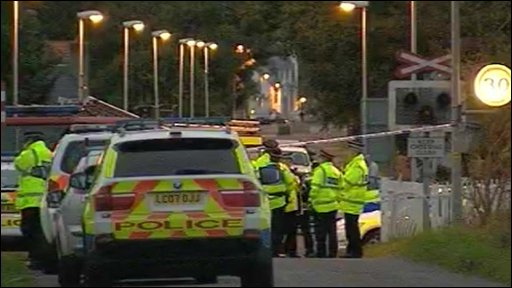 Police at the scene of the train crash in Caithness,Scotland