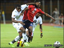 England's Nana Ofori-Twumasi (centre) tussles with David Addy (left) and Dominic Adiyiah (right)