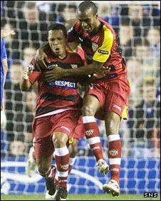 Adriano (left) celebrates scoring Sevilla's second goal