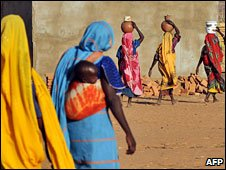 Sudanese refugee women walk at the Djabal Camp, southern Chad