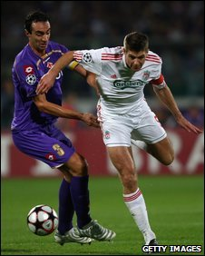 Steven Gerrard of Liverpool in action with Dario Dainellii of Fiorentina
