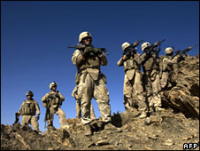 US marines on patrol through an Afghan village in Farah Province, southern Afghanistan, on 29 September 2009