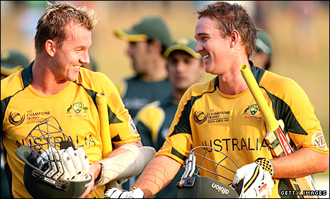 Brett Lee and Nathan Hauritz celebrate Australia's tense win
