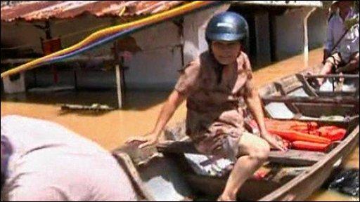 Vietnamese woman in a boat