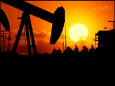 Oil drill at sunset