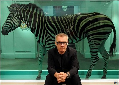Damien Hirst with his artwork, The Incredible Journey