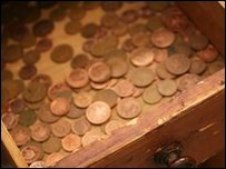 Copper coins in a drawer