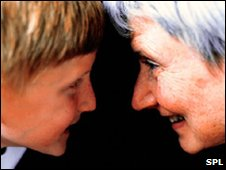 Boy looking at old woman