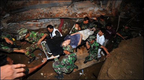 Quake survivor being removed on stretcher from wreckage of Maryani international hotel in Padang - 1 October