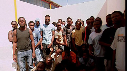 Migrants at a Libyan detention centre