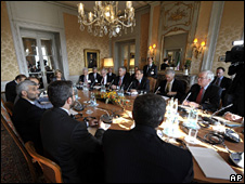 Delegates face each other across the table during the talks in Geneva. Photo: 1 October 2009
