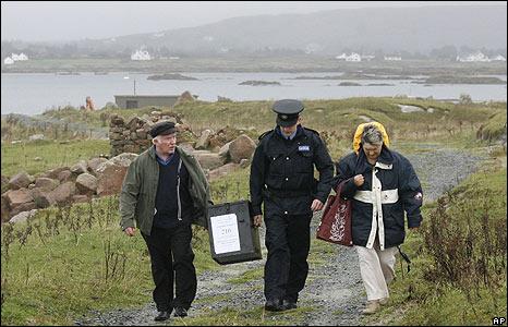 Delivering referendum ballot box on Inishfree Island, Donegal, Ireland, 30 Sep 09