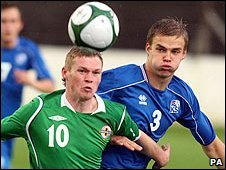 Northern Ireland's Billy McKay competes with Holmar Orn Eyjolfsson