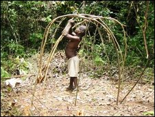 Boy building a hut