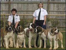 The RSPCA's Kathy Hornig and inspector Claire Kirk with six St Bernard dogs that were found abandoned at a kennel.